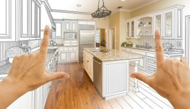 "person holding up their hands in the shape of ""L's"" envisioning new kitchen layout"