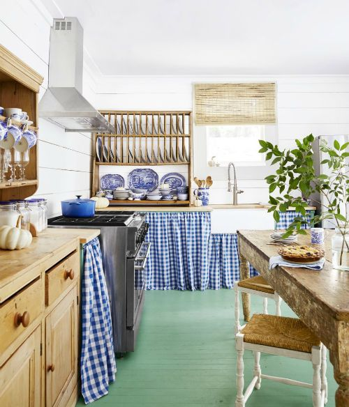 kitchen interior with retro blue gingham counter skirts and wooden shelving
