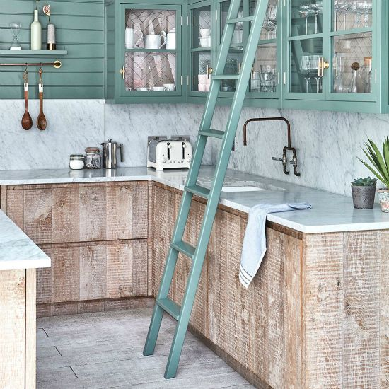 retro kitchen interior with stone countertops and aqua green painted cabinets with natural wood colored counter supports
