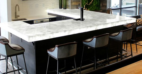 lit stone bar top with surrounding barstools