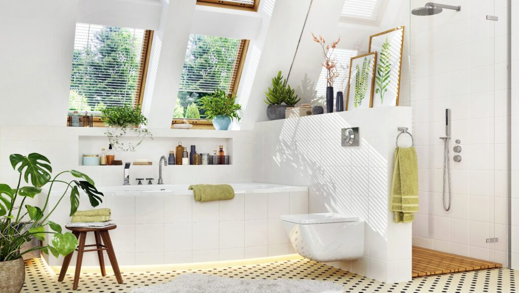 A guest bathroom with added green decor including plants, towels, and framed art.