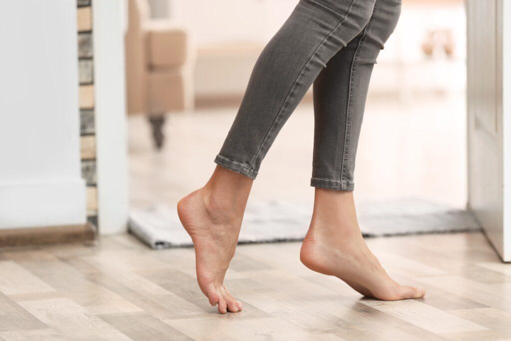 A woman walking on heated floors