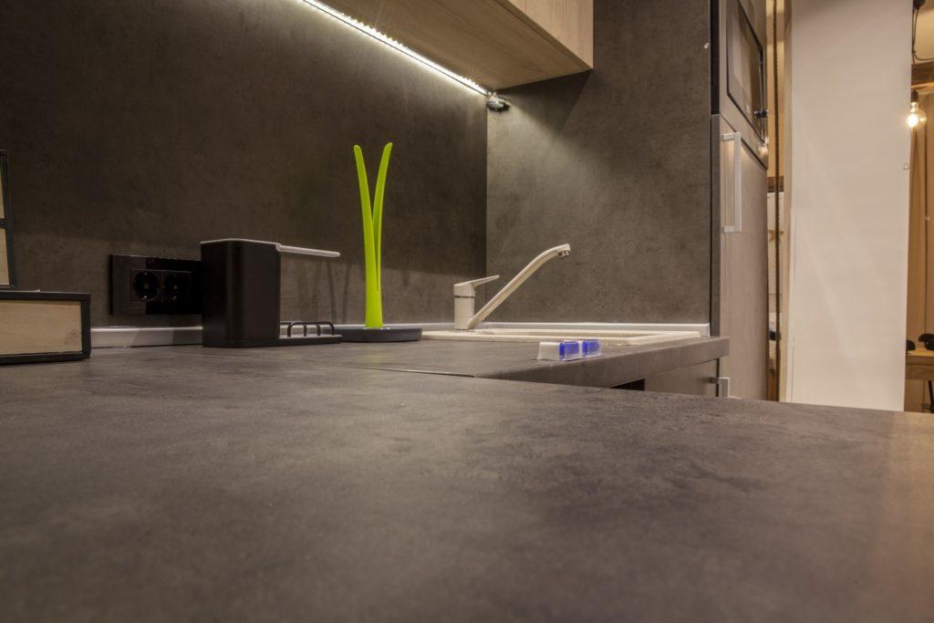 Dark concrete counters in a modern kitchen