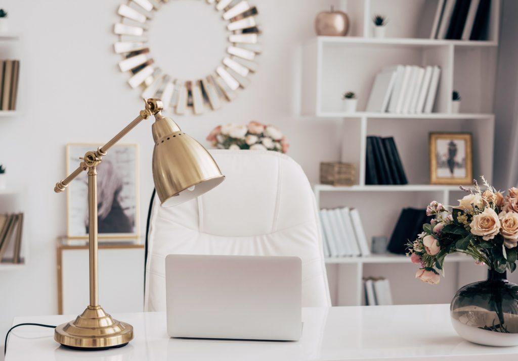 Gold desk lamp on a white stone desk